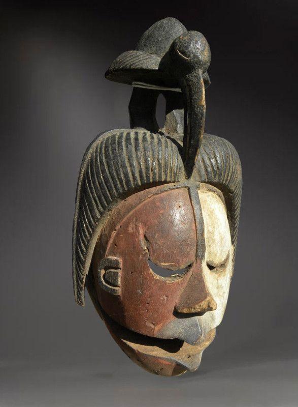 masque africain avec oiseau